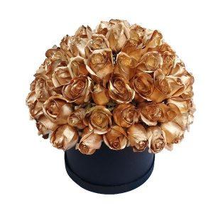 100 rosas doradas en caja redonda negra arreglo floral